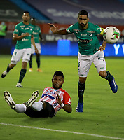BARRANQUILLA - COLOMBIA, 17-02-2021: Miguel Angel Borja de Atletico Junior y Hernan Menosse de Deportivo Cali disputan el balon, durante partido entre Atletico Junior y Deportivo Cali, de la fecha 7 por la Liga BetPlay DIMAYOR I 2021 jugado en el estadio Metropolitano Roberto Melendez de la ciudad de Barranquilla. / Miguel Angel Borja of Atletico Junior and Hernan Menosse of Deportivo Cali battle for the ball, during a match between Atletico Junior and Deportivo Cali of the 7th date for BetPlay DIMAYOR I 2021 League played at the Metropolitano Roberto Melendez Stadium in Barranquilla city. / Photo: VizzorImage / Jairo Cassiani / Cont.