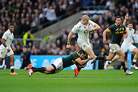 Mike Brown of England is tackled by Cobus Reinach of South Africa during the QBE International match between England and South Africa at Twickenham Stadium on Saturday 15th November 2014 (Photo by Rob Munro)