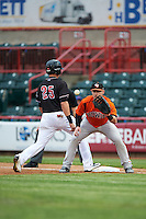 Bowie Baysox first baseman Joey Terdoslavich (7) waits for a throw as Dominic Ficociello (25) gets back to the bag with umpire Mike Provine (hidden) looking on during a game against the Erie SeaWolves on May 12, 2016 at Jerry Uht Park in Erie, Pennsylvania.  Bowie defeated Erie 6-5.  (Mike Janes/Four Seam Images)