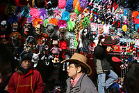 CHINA. A stall and shoppers during Chinese New Year in Ditan Park in Beijing.  Chinese New Year, or Spring Festival, is the most important festival and holiday in the Chinese calendar In mainland China, many people use this holiday to visit family and friends and also visit local temples to offer prayers to their ancestors. The roots of Chinese New Year lie in combined influences from Buddhism, Taoism, Confucianism, and folk religions.  2008