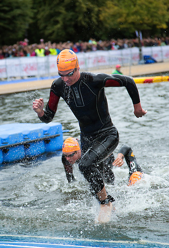15 SEP 2013 - LONDON, GBR - Jonathan Brownlee (GBR) of Great Britain leaves the water at the end of the first swim lap during the elite men's ITU 2013 World Triathlon Series Grand Final in Hyde Park, London, Great Britain (PHOTO COPYRIGHT © 2013 NIGEL FARROW, ALL RIGHTS RESERVED)