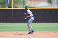 AZL Royals shortstop Maikel Garcia (4) throws to first base during an Arizona League game against the AZL Padres 1 at Peoria Sports Complex on July 4, 2018 in Peoria, Arizona. The AZL Royals defeated the AZL Padres 1 5-4. (Zachary Lucy/Four Seam Images)