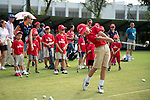 Professional golfers Marcus Freisan and Timothy Tang give a clinic to students on the side of UBS Hong Kong Open golf tournament at the Fanling golf course on 24 October 2015 in Hong Kong, China. Photo by Aitor Alcade / Power Sport Images