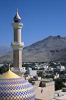 Nizwa, Oman, Arabian Peninsula, Middle East - Mosque dome and minaret.
