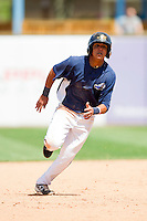 David Gonzalez (18) of the West Michigan Whitecaps hustles towards third base against the Quad Cities River Bandits at Fifth Third Ballpark on May 5, 2013 in Comstock Park, Michigan.  The River Bandits defeated the Whitecaps 5-4.  (Brian Westerholt/Four Seam Images)