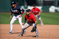 Boston Red Sox first baseman Michael Chavis (23) holds base runner Ryan Goins (8) on during a Major League Spring Training game against the Atlanta Braves on March 7, 2021 at CoolToday Park in North Port, Florida.  (Mike Janes/Four Seam Images)