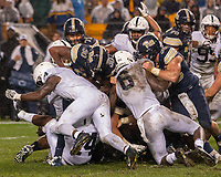 The Penn State defense led by safety Nick Scott (4) and linebacker Cam Brown (6) make a goal line stop of Pitt running back Qadree Ollison. The Penn State Nittany Lions defeated the Pitt Panthers 51-6 on September 08, 2018 at Heinz Field in Pittsburgh, Pennsylvania.