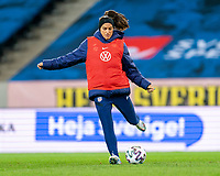 SOLNA, SWEDEN - APRIL 10: Alex Morgan #13 of the USWNT warms up during a game between Sweden and USWNT at Friends Arena on April 10, 2021 in Solna, Sweden.