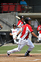 Carolina Mudcats center fielder Delvi Cid #4 at bat during a game against the Lynchburg Hillcats at Five County Stadium on April 26, 2012 in Zebulon, North Carolina. Carolina defeated Lynchburg by the score of 8-5. (Robert Gurganus/Four Seam Images)