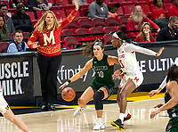 COLLEGE PARK, MD - DECEMBER 8: Head coach Brenda Frese of Maryland watches as Stephanie Karcz #10 of Loyola dribbles up court during a game between Loyola University and University of Maryland at Xfinity Center on December 8, 2019 in College Park, Maryland.