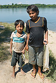 Mato Grosso State, Brazil. Aldeia Metuktire. Kayapo boys with fish.