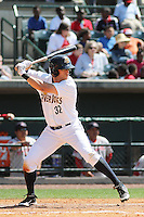 Charleston RiverDogs outfielder Brandon Thomas #32 at bat during a game against the Greenville Drive at Joseph P. Riley Jr. Ballpark  on April 9, 2014 in Charleston, South Carolina. Greenville defeated Charleston 6-3. (Robert Gurganus/Four Seam Images)