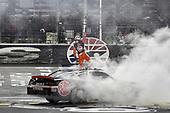 #20: Christopher Bell, Joe Gibbs Racing, Toyota Supra Rheem, does a burnout after winning