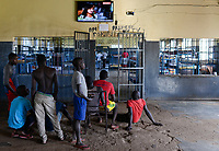 UGANDA, Kampala, Kampiringisa, national rehabilitation center, a juvenile-detention facility for children and young people, sleeping rooms with television screen at the wall/ Jugendhaftanstalt und Rehabilitationszentrum Kampiringisa, Schlafsaal mit TV