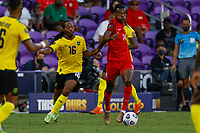 July 16th 2021; Orlando, Florida, USA; Guadeloupe midfielder Vikash Tille  and Jamaica midfielder Daniel Johnson (16) battle for the ball during the Concacaf Gold Cup match between Guadeloupe and Jamaica on July 16, 2021 at Exploria Stadium in Orlando, Fl.