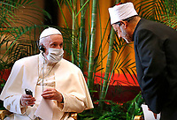 """Pope Francis talks with Sheik Ahmad el-Tayeb, grand imam of Egypt's al-Azhar mosque and university, during the meeting, """"Faith and Science: Towards COP26,"""" with religious leaders in the Apostolic Palace at the Vatican Oct. 4, 2021. The meeting was part of the run-up to the U.N. Climate Change Conference, called COP26, in Glasgow, Scotland, Oct. 31 to Nov. 12, 2021."""
