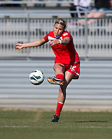 Olivia Wagner (12) of the Washington Spirit crosses the ball during the game at the Maryland SportsPlex in Boyds, MD.  The Washington Spirit defeated the North Carolina Tar Heels in a preseason exhibition, 2-0.