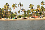 Boats on the shore near Chopdem on the Chapora River in Goa in India.