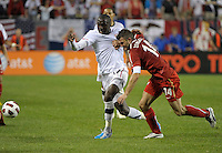 Poland defender Michael Zewlakow (14) tries to slow down US forward Jozy Altidore (17) by grabbing his jersey.  The U.S. Men's National Team tied Poland 2-2 at Soldier Field in Chicago, IL on October 9, 2010.