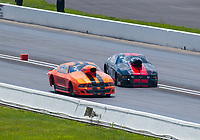 Aug 9, 2020; Clermont, Indiana, USA; NHRA mountain motor pro stock driver Brad Waddle (black) loses control and crosses centerline alongside Johnny Pluchino during the Indy Nationals at Lucas Oil Raceway. Mandatory Credit: Mark J. Rebilas-USA TODAY Sports