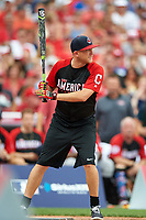 Country music star Justin Moore bats during the All-Star Legends and Celebrity Softball Game on July 12, 2015 at Great American Ball Park in Cincinnati, Ohio.  (Mike Janes/Four Seam Images)