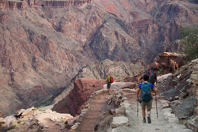 hikers making the long steep decent to the colorado river at the bottom of the grand canyon