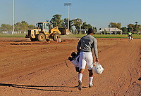 Sept. 16, 2009; Casa Grande, AZ, USA; California Redwoods running back Derrell Hutsona runs past a bulldozer on his way to the field during training camp at the Casa Grande Training Facility & Performance Institute. Mandatory Credit: Mark J. Rebilas-