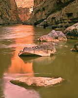 Sunrise light reflected in the Rio Grande River in Santa Elena Canyon; Big Bend National Park, TX