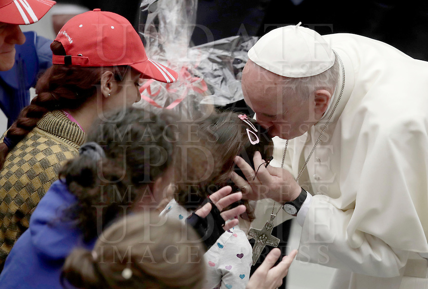 Francesco bacia una bambina un'udienza ai partecipanti al Giubileo delle Persone socialmente escluse, in aula Paolo VI, Citta' del Vaticano, 11 novembre 2016.<br /> Pope Francis kisses a child as he arrives to attend a Jubilee audience with people socially excluded in Paul VI hall at the Vatican 11 November, 2016.<br /> UPDATE IMAGES PRESS/Isabella Bonotto<br /> <br /> STRICTLY ONLY FOR EDITORIAL USE