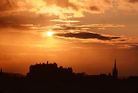 .The skyline of Edinburgh Castle seen against a sunset sky, Edinburgh, Scotland...
