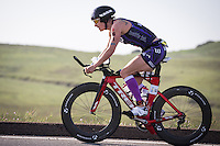 Rachel McBride competes during the bike portion of the Accenture Ironman California 70.3 in Oceanside, CA on March 29, 2014.