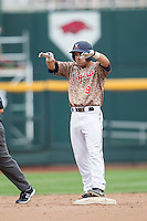 Virginia Cavaliers third baseman Kenny Towns (9) celebrates after driving in a run in the ninth inning double against the Arkansas Razorbacks in Game 1 of the NCAA College World Series on June 13, 2015 at TD Ameritrade Park in Omaha, Nebraska. Virginia defeated Arkansas 5-3. (Andrew Woolley/Four Seam Images)