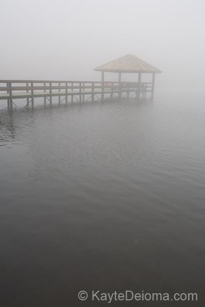 A pier on the pond disappears into the fog at Rio do Rastro Eco Resort, Santa Catarina, Brazil