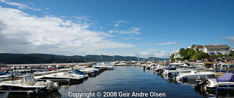 View of Holmsbu harbour, crowded with boats at summer, just outside of Oslo, Norway