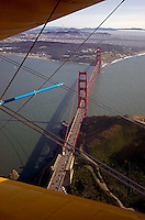 aerial photograph Golden Gate bridge from Stearman aircraft, San Francisco, California