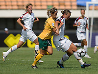 USWNT forward (20) Abby Wambach holds back Australia's (13) Amy Chapman during the Peace Queen Cup  in Suwon, South Korea.  The U.S. defeated Australia, 2-1, at the Suwon Sports Complex.