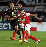 BOGOTA -COLOMBIA, 27 -JULIO-2014. Luis Carlos Arias de  Independiente Santa Fe en accion  contra  Fortaleza FC durante partido   de La Liga Postobón 2014-2. Estadio El Campin  . / Luis Carlos Arias of Independiente  Santa Fe in actions against  Fortaleza FC Liga Postobón match during 2014-2.  El Campin Satadium . Photo: VizzorImage / Felipe Caicedo / Staff