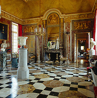 The marble and porphyry bust on the ornate marble fireplace in the main salon is of the Emperor Nero