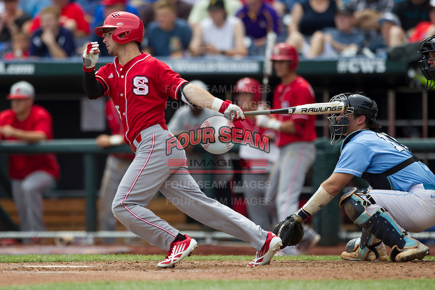 North Carolina State outfielder Bryan Adametz (15) follows through on his swing during Game 3 of the 2013 Men's College World Series between the North Carolina State Wolfpack and North Carolina Tar Heels at TD Ameritrade Park on June 16, 2013 in Omaha, Nebraska. The Wolfpack defeated the Tar Heels 8-1. (Andrew Woolley/Four Seam Images)