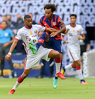 AUSTIN, TX - JULY 29: Gianluca Busio #6 of the United States and Abdelaziz Hatim #6 of Qatar battle for control of the ball during a game between Qatar and USMNT at Q2 Stadium on July 29, 2021 in Austin, Texas.