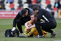 Mark O'Brien of Newport County is seen to by physios after a collision during the Sky Bet League Two match between Newport County and Yeovil Town at Rodney Parade, Newport, Wales, UK. 14 April 2017