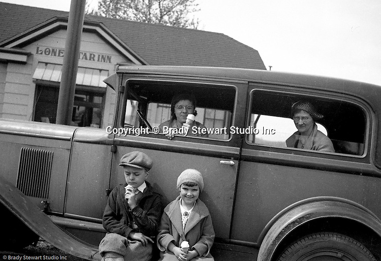 Markleysburg PA:  Stewart family taking a break off Route 40 on the way home from a vacation at Youghiogheny Lake. View the Stewart family; Helen, Sarah, Brady Jr., and Sally eating ice cream cones in front of the Lone Star Inn which is still operating off Route 40.  Stewart's traveling in a 1928 Chevrolet AB National Coach