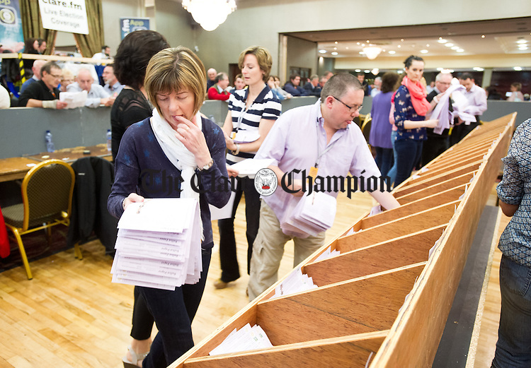 Counters begin the first count during the election count at The West county Hotel, Ennis. Photograph by John Kelly.