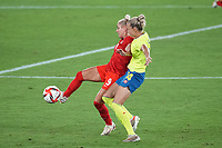 YOKOHAMA, JAPAN - AUGUST 6: Adriana Leon #9 of Canada is defended by Nathalie Bjorn #14 of Sweden during a game between Canada and Sweden at International Stadium Yokohama on August 6, 2021 in Yokohama, Japan.