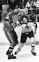 Violence on ice: Maple Leafs' Dave Hutchison lands a mean right fist to the jaw of Montreal Canadien Larry Robinson during a game in the mid-'70s, when violence was at its height in NHL.<br /> <br /> Bezant, Graham<br /> <br /> 1978<br /> <br /> PHOTO : Graham Bezant - Toronto Star Archives - AQP