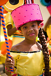A young girl in a pink hat and costume relaxes before the start of the parade for the ZomerCarnaval (Summer Carnival) in Rotterdam, the Netherlands. The street parade is the colorful high point of the Rotterdam carnival. It is a tropical themed parade with over 2000 participants and travels 6km through the center of Rotterdam.