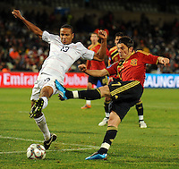 David Villa of Spain shoots at goal under pressure from Ricardo Clark of USA. USA defeated Spain 2-0 during the semi-finals of the FIFA Confederations Cup at Free State Stadium in Manguang/Bloemfontein, South Africa on June 24, 2009..