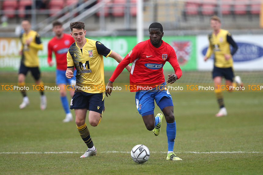 Saidou Khan of Dagenham and Redbridge and John Freeman of Woking during Dagenham & Redbridge vs Woking, Vanarama National League Football at the Chigwell Construction Stadium on 3rd May 2021