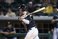 Matt Davidson (22) of the Charlotte Knights follows through on his swing against the Louisville Bats at BB&T BallPark on May 12, 2015 in Charlotte, North Carolina.  The Knights defeated the Bats 4-0.  (Brian Westerholt/Four Seam Images)
