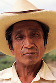 La Coipa, Peru. Old man with a few day's stubble wearing a wide brimmed straw hat.